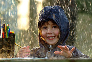 photo of schoolkid in the rain, from metro.co.uk
